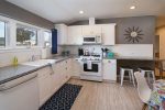 Kitchen features full size appliances including a dishwasher