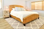Master bedroom has a king bed and has a beautiful and peaceful decor.