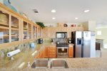 This high-end kitchen is fully equipped to prepare a gourmet meal.