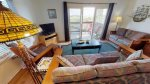 Comfortable living area looking out onto the marsh with queen sleeper sofa and large flat panel TV with DVD player