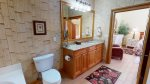 Master bathroom with large single sink vanity, jetted tub and separate shower