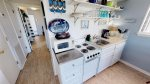 Fully functional kitchenette with all the necessary appliances and cookwares - dishwasher included