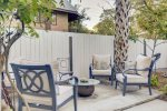 Large back yard patio with two seating areas