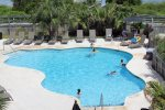 Enjoy the large free form fresh water pool and patio