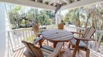 Large balcony entrance area with bar height Adirondack and comfortable wicker lounge chairs