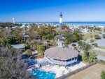 Tybee Island`s famous lighthouse sits just beyond the house of similarly inspired design.