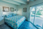 The master bedroom suite has a king-size bed with its own private bathroom. Sliding glass doors provide access to the private, secured, wood-fenced back yard oasis. Plenty of native palm trees, magnolia, and oak trees provide shade, if needed, and deck ch