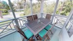 Cool breezes will refresh you on the porches which extend the entire distance of the front of the home.