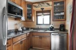 Renovated kitchen with microwave/convection oven and does not have a full-size oven .