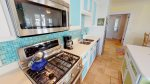 1st Level - Modern kitchen with all the necessary cookwares, stainless steel appliances, and gorgeous gas range
