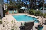 Beautiful in-ground pool, tiki bar, flat-screen TV`s, covered balcony, grill, and outdoor showers located in the back yard