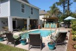 Beautiful in-ground pool, tiki bar, covered balcony, grill, and outdoor showers located in the back yard