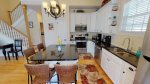 Gorgeous kitchen with upgraded appliances, center island with additional seating, and all the necessary cookwares