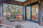 Enclosed porch to read a book, play board games, or visit with friends and family