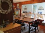 A large custom-made dining table seats 8 with room to spare. Perfect for family gatherings.