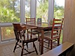 A small table at the end of the upstairs breezeway is perfect for laptop work, jigsaw puzzles, board gamesor a meal.