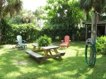 Enjoy outdoor activities in the backyard with picnic table and beach shower