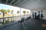 Large, private balcony with plenty of seating for all to take in the ocean sounds and breezes