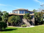 Modern comforts and panoramic ocean vistas abound in this exceptional historic Tybee Island beach house