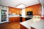 Fully stocked large kitchen with stainless steel appliances located on the 2nd floor