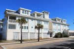 Deluxe vacation condominium with swimming pool. Just a short walk to the beach, shops, restaurant, pier, and Pavilion.