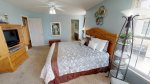 Gorgeous master bedroom with astonishing views, king bed, flat-screen TV, balcony access, and adjoining master bathroom