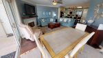Mounted flat-screen TV, dining area, queen sized sofa sleeper, balcony access