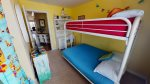 Guest bedroom 2 - Kids room with bunk beds - Single mattress on top, full mattress on bottom with a TV