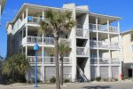 This condo features a spacious interior, large wrap-around balcony, panoramic views of Tybee Beach, its close to everything and steps to the beach