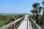 Boardwalk access to beach located steps from your condo and pool