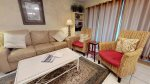 Comfortable living area with queen sleep sofa and TV/DVD