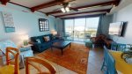 Comfortable furnishings, mounted flat-screen TV, gorgeous views, and balcony access