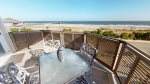 Panoramic vistas of the Atlantic Ocean and Tybee Beach from your private balcony