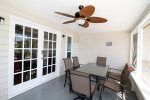 Enjoy the sounds of the surf and Tybee breezes from your screened front porch