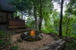 Enjoy the ambiance of the fire-pit while staying warm in the hot tub
