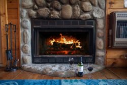 Enjoy a glass of wine in front of the wood burning fireplace