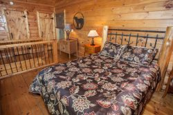 Queen bed upstairs in loft. Upstairs bathroom located a short distance away