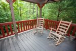 Get comfortable in our rocking chairs overlooking the forest on the back porch