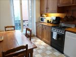 Spacious kitchen with view of courtyard, Italian tiles & antique table