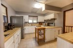 Open floor plan main living area/Living Room with lovely large windows and glass patio doors to the deck overlooking the lake