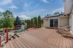 Large gas grill and Green egg smoker on the deck, just off of the kitchen