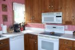 Fully equipped kitchen with gorgeous restored cabinets, stove/oven, refrigerator and dishwasher