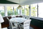 Dining Area in the enclosed porch, just off of the Living Room.  Large windows overlooking Keuka Lake