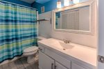 Hall bath with tub/shower and washer/dryer