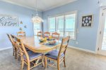 Dining area with plenty of seating and ocean view