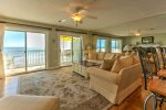 Beautifully decorated living area opening onto ocean front deck