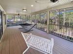 Master bedroom screen porch overlooking pool with hammock