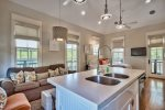 Beautiful Kitchen Island Seating Four Opens to the Liesure Area