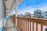 2nd floor terrace with seating and a glimpse of the beautiful Panama City Beach.