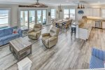 The open living and kitchen area features a beautiful view of the Gulf of Mexico